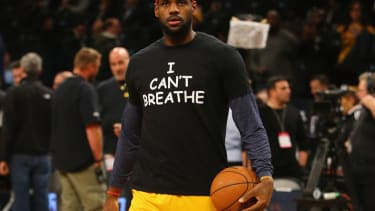 LeBron James, Brooklyn Nets players warm up in 'I Can't Breathe' protest shirts