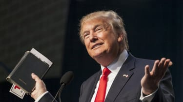 President Donald Trump holds his bible while speaking.