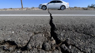 A crack in a California road caused by an earthquake.