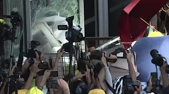 Hong Kong protesters smash window at legislature