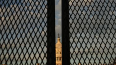 The Capitol behind fences.