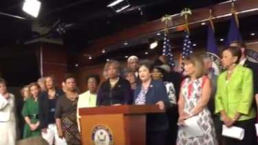 House Democratic women holding a press conference.