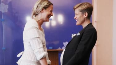 Stefanie Berks and Daisy Boyd hold hands before their marriage ceremony on June 28 in New York City.