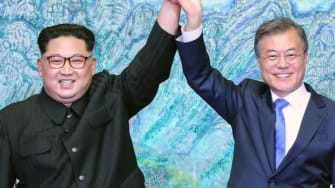 North Korean leader Kim Jong Un (L) and South Korean President Moon Jae-in (R)