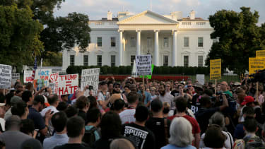 Protesters outside the White House after the Charlottesville events