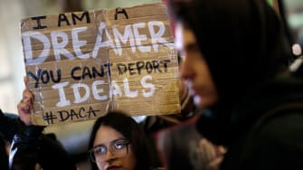Activists rally for the passage of a 'clean' Dream Act, one without additional security or enforcement measures, outside the New York office of Sen. Chuck Schumer (D-NY), January 10, 2018 in