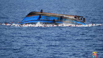 Migrant boat overturns off Libyan coast