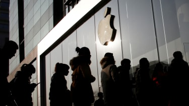 People line up at an Apple store in Beijing.