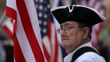 Tea Party activist Roy Allen listens to political speeches in Fort Collins, Colorado.