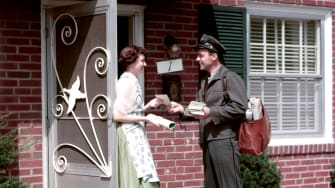 A postman delivering mail.
