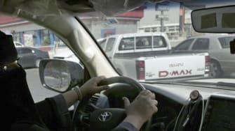 A Saudi woman drives her car.