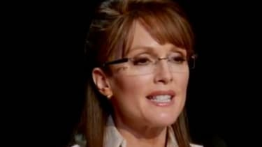 """Julianne Moore's turn as Sarah Palin is teased in a new clip from HBO's """"Game Change,"""" and some critics are convinced she's every bit as good as Tina Fey."""