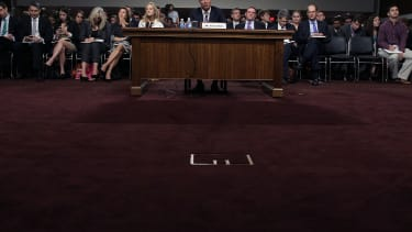 President and CEO of JPMorgan Chase Co. Jamie Dimon testifies before a Senate Banking Committee in June 2012.