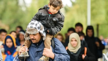Migrants cross Slovenian-Austrian border