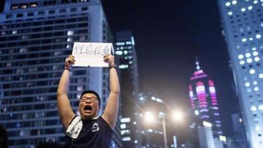 Hong Kong activists debate government officials on democracy