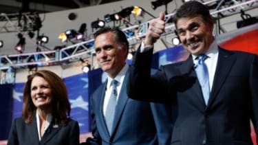 Frontrunners Gov. Rick Perry and Mitt Romney will take to the debate stage Monday in the first Tea Party hosted event and fight it out for key primary states.