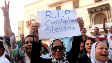 A demonstrator holds a sign during a rally in Benghazi