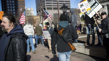 When the gun debate comes up, people cling to their political party's opinion instead of finding middle ground.