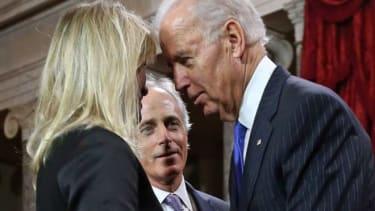 Vice President Joe Biden whispers to Sen. Bob Corker's wife. The senator looks none too pleased.