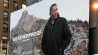 Without asking his permission, outerwear company Weatherproof used a news photo of Barack Obama wearing one of its jackets on a Times Square billboard. (AP Photo/Julie Jacobson)
