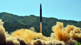 This picture taken on July 4, 2017 and released by North Korea's official Korean Central News Agency (KCNA) on July 5, 2017 shows the successful test-fire of the intercontinental ballistic mi