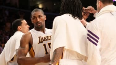 Metta World Peace leaves the court after being ejected for elbowing James Harden in the head: The star forward has been suspended 13 times over his career.