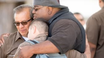 UPS workers console each other after a workplace shooting in San Francisco on Wednesday.