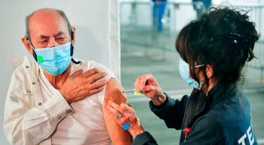 A man gets a coronavirus vaccine.
