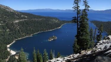 Emerald Bay lies under blue skies at Lake Tahoe on July 23, 2014 near South Lake Tahoe, California. Lake Tahoe is among Califonria's major tourist attractions.