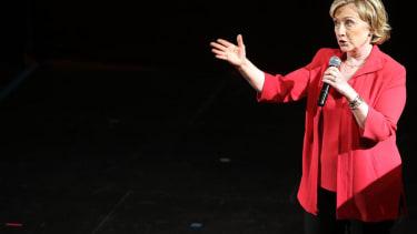 Hillary Clinton tacks right: praises Bush, criticizes Obama, cozies up to Wall Street