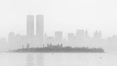 New York's skyline as seen from the bridge to Ellis Island