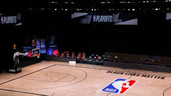 An empty court and bench is shown with no signage following the scheduled start time in Game Five of the Eastern Conference First Round between the Milwaukee Bucks and the Orlando Magic durin