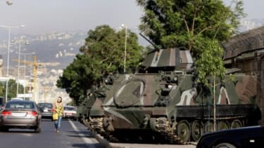 An armored tank sits outside the official residence of the French ambassador to Lebanon in Beirut