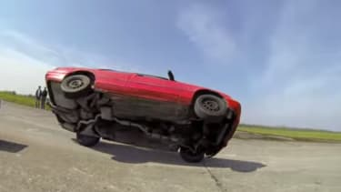 Watch this driving pro balance a car on two wheels