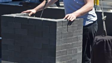 Elon Musk speaks from his lectern of bricks.