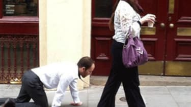Man seen walking on a leash was a 'theatrical project,' woman explains