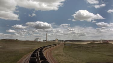 A pair of coal trains travel through Gillette, Wyoming.