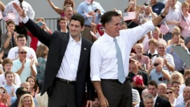Mitt Romney and Rep. Paul Ryan (R-Wis.) wave as Ryan is announced as Romney's vice presidential running mate in front of the U.S.S. Wisconsin on Aug. 11 in Norfolk, Va. Ryan, a seven term con