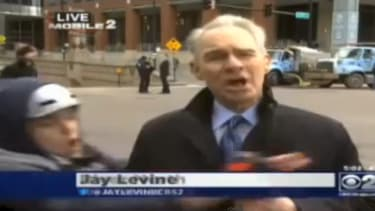 Watch a Chicago reporter fend off an anti-Obama protester on live TV