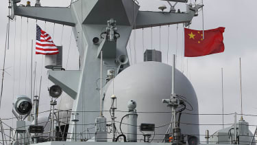 Chinese and American flags fly on the Chinese Navy frigate called Yancheng in San Diego on December 6, 2016 during a four day visit to California.