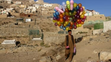 An Afghan man wanders through Kabul trying to sell his balloons, on Oct. 17, 2011.