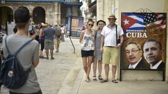 Tourists pose ahead of President Obama's historic visit with Raúl Castro