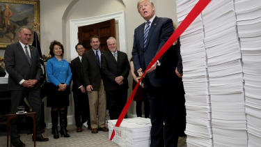 President Trump cuts bureaucratic red tape at a White House event in 2017.