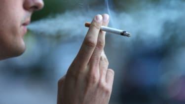A man smokes a cigarette.
