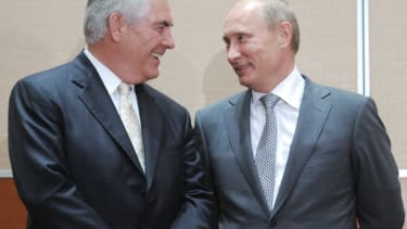 Rex Tillerson shares a smile with Vladimir Putin in 2011.
