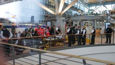 Authorities investigate an apparent airborne irritant in Hamburg airport