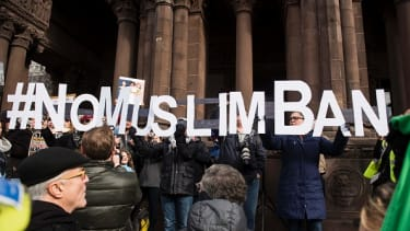 Protesters react to a ban on travel from certain majority-Muslim countries.