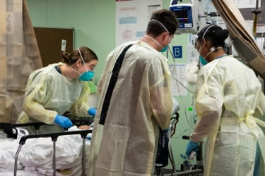 Sailors assigned to the hospital ship USNS Mercy (T-AH 19) treat the first patient from Los Angeles medical facilities March 29