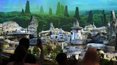 Fans view a model of the new Star Wars theme park that will open in the California and Florida Disneyland Parks in 2019 during the D23 expo fan convention