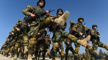 Afghan soldiers marching in uniform.